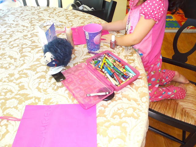 DSC06494 Hayley is putting together her party favors with some Infinity Loofah #MascotWear! #cbias
