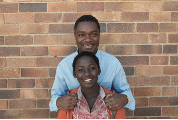 David Oyelowo as Robert Katende and Madina Nalwanga as Phiona Mutesi in Disney's Queen of Katwe.