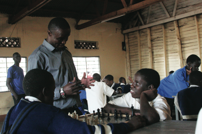 Robert Katende and Phiona Mutesi at Robert's chess program.