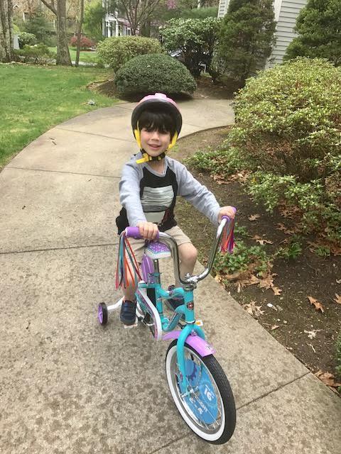 Even boys ride pink bikes!