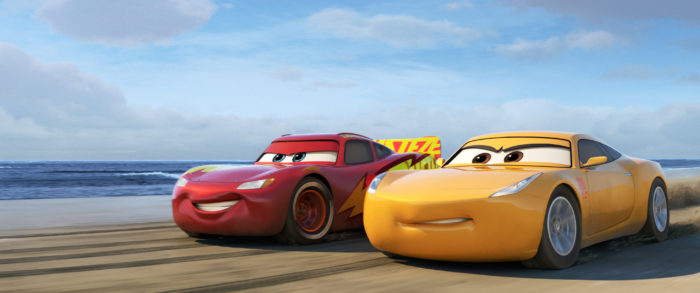 Lightning McQueen (voice of Owen Wilson), alongside elite trainer Cruz Ramirez (voice of Cristela Alonzo). © 2017 Disney•Pixar.